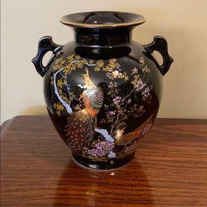 Vintage  porcelain black vase with golden trim.
